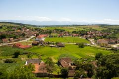 Landscape of Cincu village, Brasov County, Romania. View from the the tower of the Cincu fortified church, Brasov County, in Transylvania, Romania royalty free stock photo