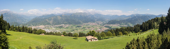 Landscape on the cities of Clusone and Rovetta from the mountain lodge called San Lucio. During summer time Royalty Free Stock Image
