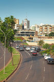 Landscape of the city of Campo Grande. City with some buildings between trees, car traffic and urban art. Stock Photography