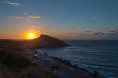 Landscape of city of Castelsardo at sunset. A view of Castelsardo , Sardinia, with the light of sunset Royalty Free Stock Image