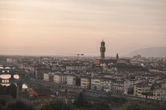 Italy on a long-focus lens, view from the playground on the Arno River and the Palazzo Vecchio in the evening sunset royalty free stock photography