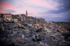 The landscape of the city of matera at sunset stock images