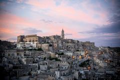 The landscape of the city of matera at sunset royalty free stock image