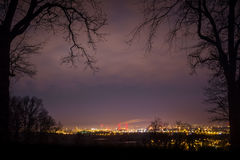Landscape of city by night and contours of trees, Szczecin, Poland.  royalty free stock image
