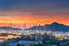 Landscape of city and oil refinery plant at twilight Stock Photography