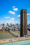 A landscape city view of St. Paul`s Cathedral, The millennium Bridge and The Tate Modern Gallery and old Chimney. Royalty Free Stock Images