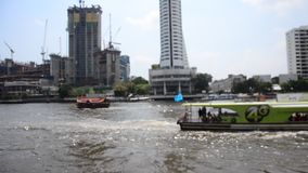 Landscape and cityscape with many boat in traffic water at chao phraya river. BANGKOK, THAILAND - FEBRUARY 16 : Landscape and cityscape with many boat in traffic stock video footage