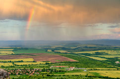 Landscape,cityscape,Parks. Cityscape with rainbow over the city during rainy day Stock Image