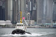Landscape and cityscape and Star Ferry crossing Victoria Harbour between kowloon and Hong Kong islandr stock images