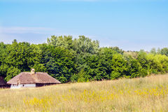 Landscape clay and wooden hut thatched Ukrainian Royalty Free Stock Photo