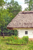Landscape clay and wooden hut thatched Ukrainian Royalty Free Stock Images