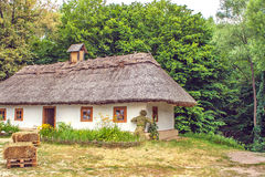Landscape clay and wooden hut thatched Ukrainian Stock Image
