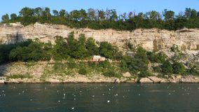 Landscape of a cliff next to the river stock footage