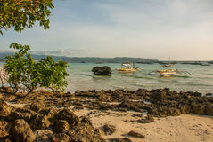Landscape: cliffs and the sea with boats. Boracay island. Philippines. Royalty Free Stock Image