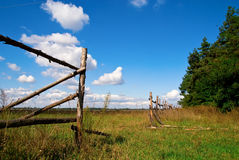 Landscape with clouds. Fence stand on landscape with clouds on blue sky Stock Image