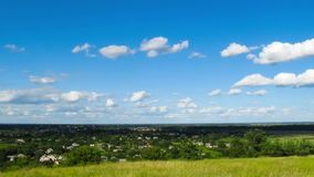 Landscape, clouds moving over a field with trees stock footage