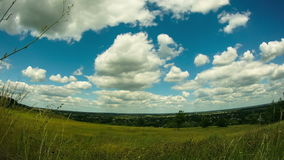 Landscape, clouds moving over a field with trees stock video footage