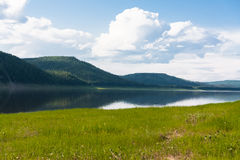 Landscape with clouds over water. Tunguska river. Stock Photos