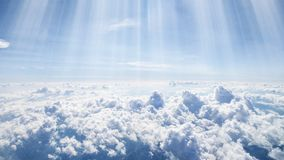 Landscape of clouds and sunbeams seen from above from an airplane windows. Pretty panorama of a cloudscape a landscape of clouds and sunbeams seen from above royalty free stock photography
