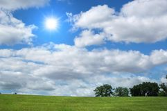 Landscape with clouds and tree Stock Photos