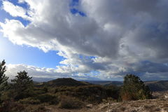 Landscape and cloudy skies in Corbieres, France Royalty Free Stock Image