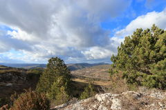 Landscape and cloudy skies in Corbieres, France Stock Photo