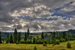 Landscape with cloudy sky. Highlands landscape with cloudy sky Royalty Free Stock Photos