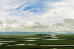 Landscape of cloudy sky and green steppe Royalty Free Stock Image