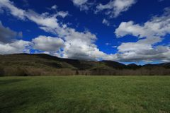 Landscape and cloudy sky in Pyrennes. Royalty Free Stock Photo