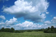 Landscape with cloudy sky Royalty Free Stock Image