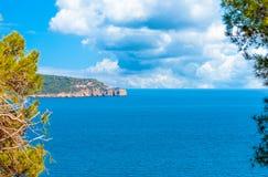 Landscape of coast of Capo Caccia. Sea, blue, coastline, italy, sardinia, summer, sky, water, mediterranean, vacation, travel, nature, tourism, rock, beautiful stock photos