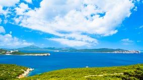 Landscape of coast of Capo Caccia. Sea, blue, coastline, italy, sardinia, summer, sky, water, mediterranean, vacation, travel, nature, tourism, rock, beautiful stock photography