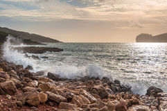Landscape of coast of Capo Caccia at sunset. Landscape of coast of Capo Caccia from Punta Giglio at sunset in winter Royalty Free Stock Photos