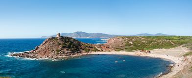 Landscape of the coast of porticciolo beach in a windy day of autumn. Alghero, the island of Sardinia. Italy Royalty Free Stock Photo