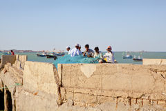 Fishermen mending nets at Bet Dwarka Stock Photos
