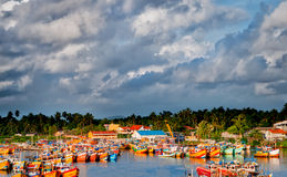 Landscape of colored fishing  boats. With dark clouds Royalty Free Stock Photography