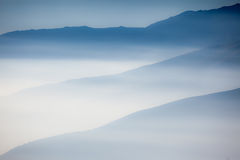 Landscape with colorful layers of mountains and haze in the vall Royalty Free Stock Photography