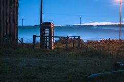 Misty Phone Box. A landscape colour image of a UK telephone box taken on a misty evening in June on the Isle of Islay, Scotland. 10 June 2012 Stock Images