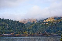 Landscape with Columbia River in the morning haze mountains and. Landscaping panorama of truss bridge across the Columbia River duct in the Hood River Columbia royalty free stock image