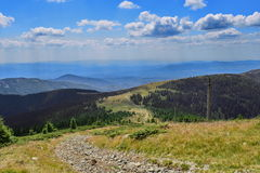 Landscape with country road at Curcubata Mare in the Apuseni mountains. Stock Photography
