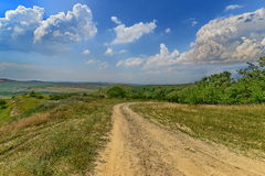 Landscape with country road to the Cojocna baths Stock Photo