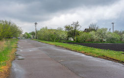 Landscape with country road to remote village Terny, Poltavskaya oblast, Ukraine Stock Photo