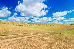 Landscape of countryside with fields on the background of blue s Royalty Free Stock Images