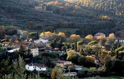 Landscape of the counytryside near Arezzo with a village, hills and mountains in autumn colors stock photography