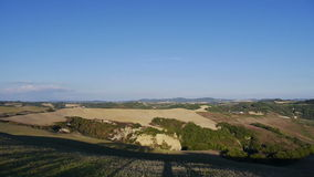 Landscape of Crete Senesi. Pan of the landscape of the Crete Senesi in Tuscany, Italy stock video footage