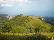 The landscape is the Crimean mountains. Vertex. Green Peak sky clouds Royalty Free Stock Image