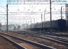 Landscape with the crossing of railway tracks with multiple trains stock photo