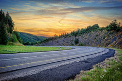 Landscape with curvy road at sunset Royalty Free Stock Photography