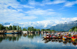 Landscape of Dal Lake in Srinagar, India. Srinagar, India - Jul 23, 2015. Wooden boats on Dal Lake in Srinagar, India. The lake is also an important source for royalty free stock photos