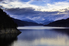 Landscape with dam lake Vidraru in Romanian mountains, in the wi Stock Photography